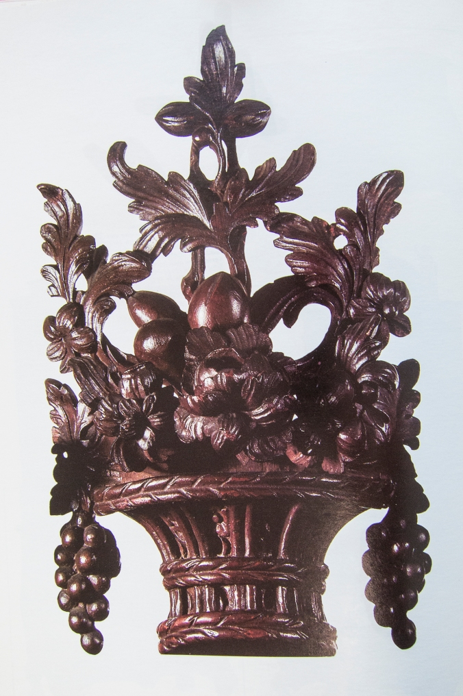 The large blossom of this cartouche appears to have been detached and re-glued to its platform upside down.